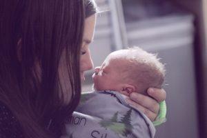 Newborn nose to nose with parent